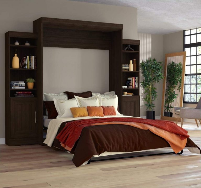 Open Murphy bed with bedding and pillows on