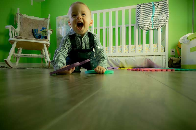 toddler playing happily on the floor