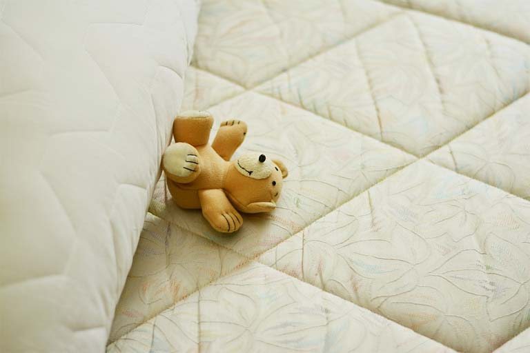 toy bear on the mattress hybrid mattress vs memory foam