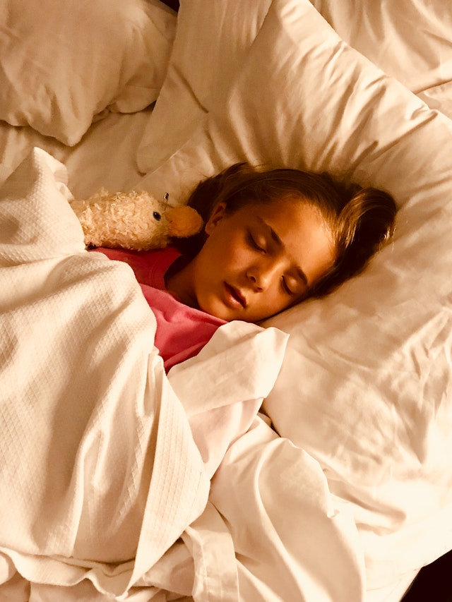 girl-sleeping-on-bed